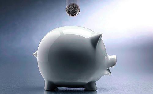 Coin Dropping Into Piggy Bank